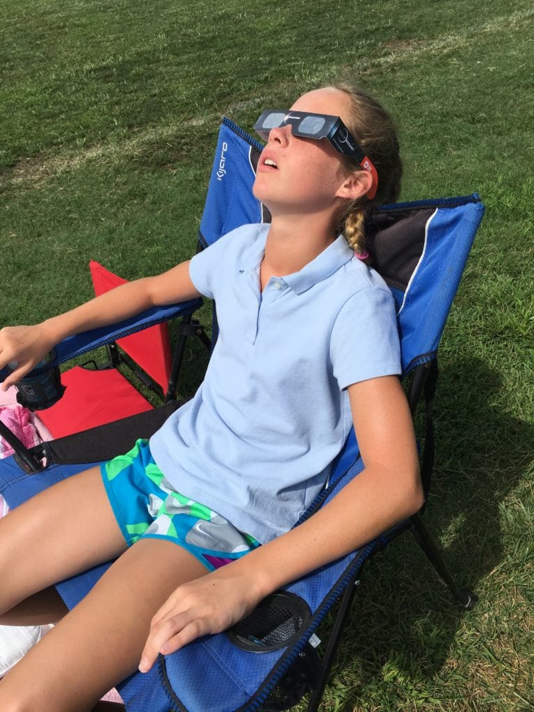 Experiencing the Solar Eclipse Path of Totality - Delaney watched as the sun disappeared behind the moon - saying it looked like the Cheshire Cat from Alice in Wonderland